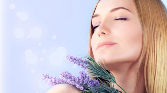 woman enjoying flower lavender scent
